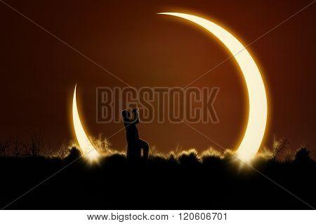 Man Using Binoculars To Watch Solar Eclipse