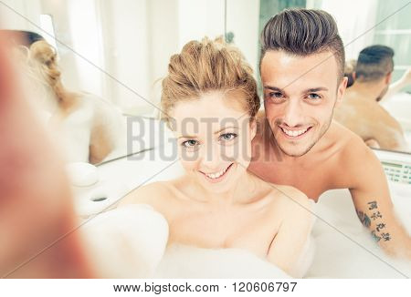 Young Happy Couple Enjoying Jot Bath In The Jacuzzi