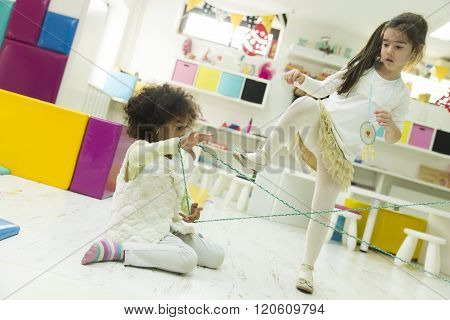 Multiracial Children Playing In The Playroom