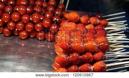 strawberry and tomato glazed on stick in Taiwan night market