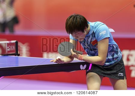 KUALA LUMPUR, MALAYSIA - MARCH 01, 2016: Ding Ning of China plays prepares to serve in her match in the Perfect 2016 World Team Table-tennis Championships held in Kuala Lumpur, Malaysia.
