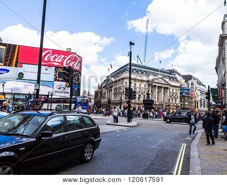 LONDON- JUNE 6 2015 : People and traffic in Picadilly Circus. A famous public space in London's West Endit was built in 1819 to join Regent Street with the shopping street of Picadilly