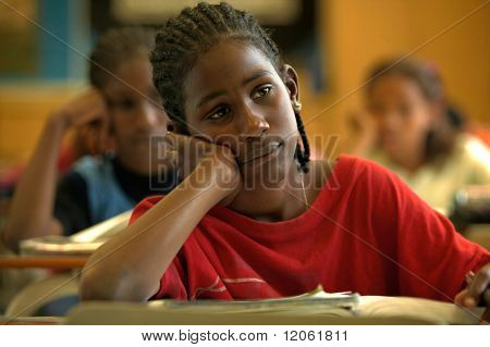 Pre-adolescent boy daydreaming at desk