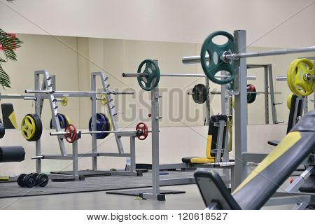 Barbellsand Athletic Bench At The Gym