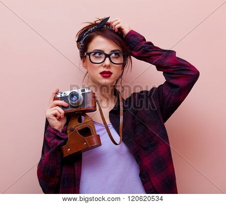 Portrait Of A Young Woman With Camera