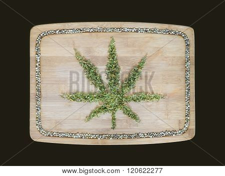 Cannabis Symbol Made Of Dried Hemp Leaves On A Wooden Bamboo Board