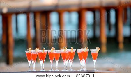 Glasses Of Red Cocktail At The Beach Party
