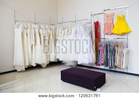Wedding dresses on hangers in the store