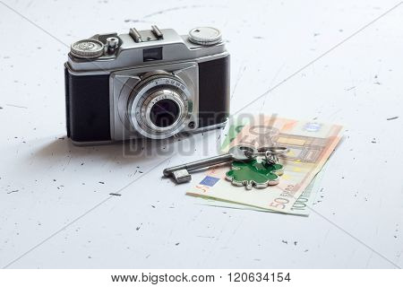 Old Retro Camera With Euro Banknotes