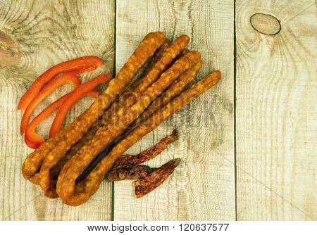 Bunch Of Kabanos Smoked Sousage On Wooden Background