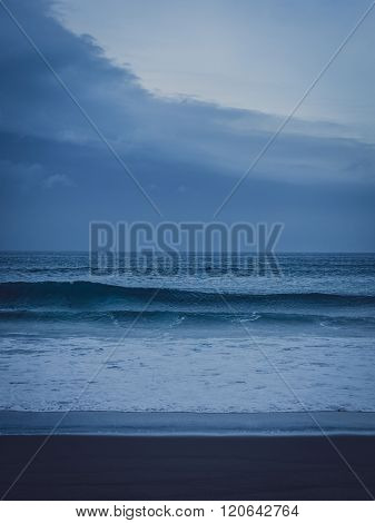 Rainy clouds over the ocean on the coast of Sao Miguel Island in the Azores, Portugal