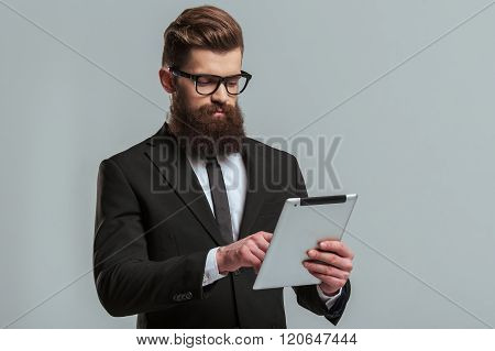 Bearded Businessman With Gadget