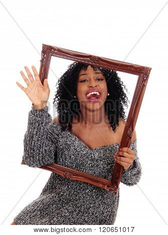 African American Woman Holding A Picture Frame.