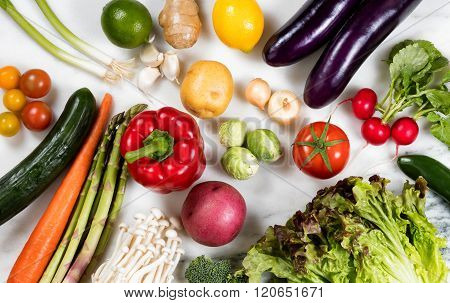 Whole Vegetables And Fruit On Natural Marble Stone Background