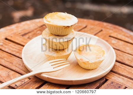 Mini pies on wooden plate, stock photo