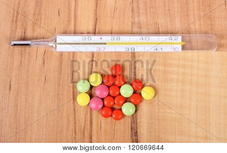 Thermometer And Pills For Colds, Treatment Of Flu And Runny