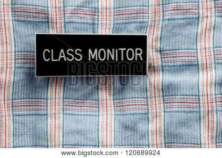 Class Monitor Badge On Checked Shirt