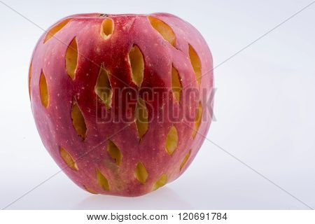 Rotten red apple on a white background