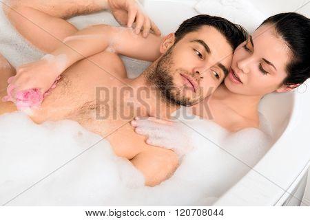 beautiful couple is taking a bath