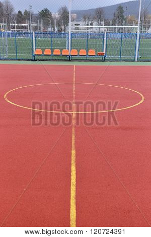 Soccer Field Made From Red Granule Rubber. Football Field Background. Center Of Playground. Red Chai