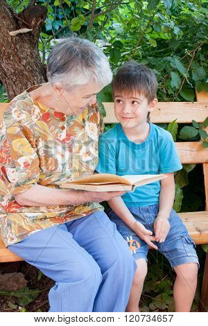 A Great-grandmother Reads A Book To The Great-grandchild