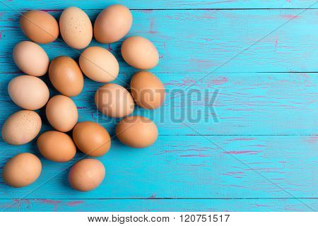 Fresh Healthy Brown Eggs On A Colorful Blue Table