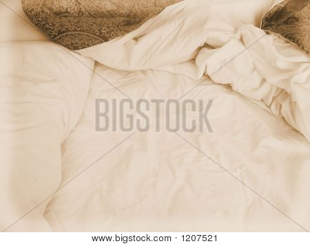 Crumpled Bed Sheets And Quilt From Above