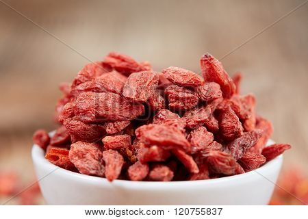 Goji Berries In A White China Bowl On A Table