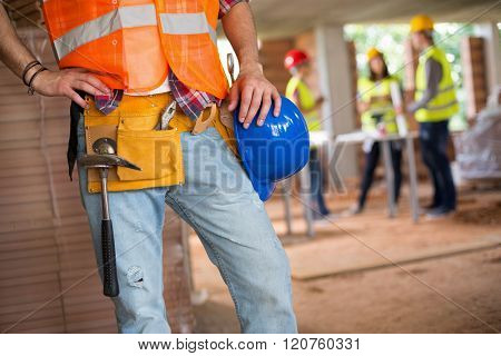 Young construction workman communicate with walkie talkie