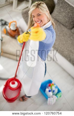 Nice fanny hostess make joke with products for cleaning house