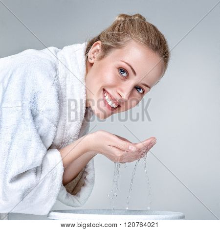 Young Woman Washing Face