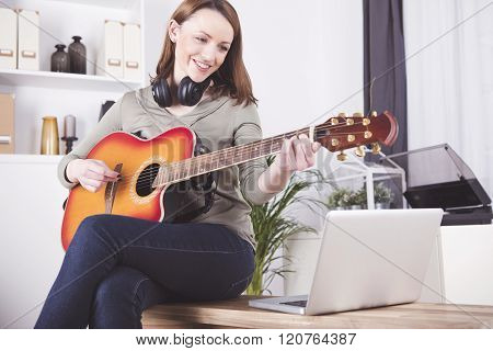 young beautiful happy girl indoors at home