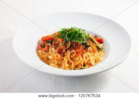 pasta with vegetables tomatoes zucchini peppers isolated on white background tomato sauce Round plate menu cafe restaurant