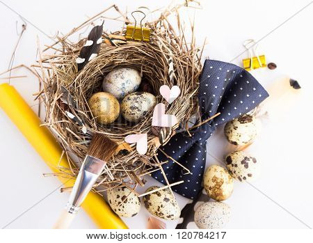 Photo With Easter Eggs Nest Brush And Feathers On A White Studio Background