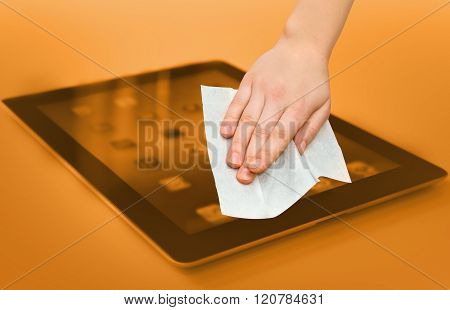 hand with white wet wipe tablet cleaning