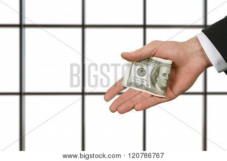 Businessman holding money in office.