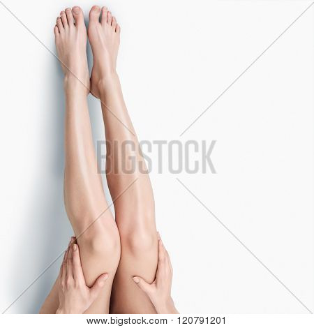 Beautiful long slim female legs isolated on white background
