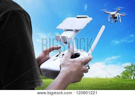 Male Pilot Controlling Drone