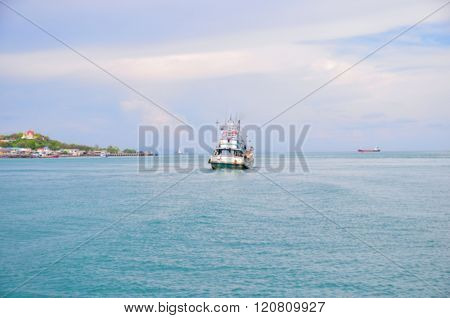 Fisheries boat in the blue ocean, blur background