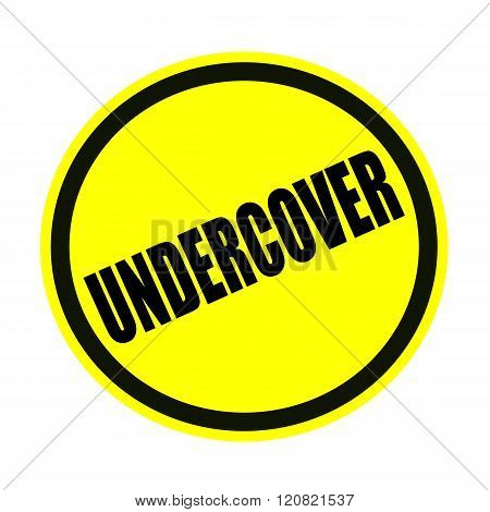 an images of UNDERCOVER black stamp text on yellow