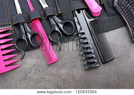 Professional hairdressing equipment in black case on grey background