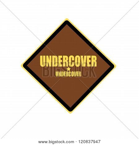Undercover Yellow Stamp Text On Brown Background