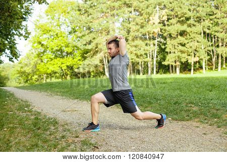 Young Man Stretching In The Park