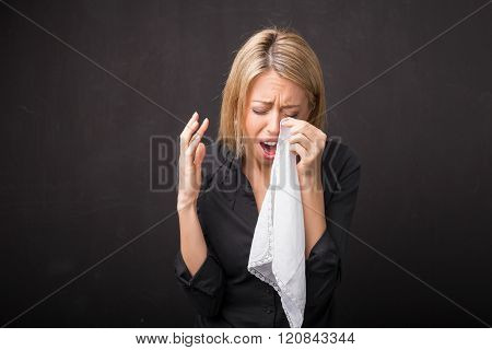 Woman crying and wiping  her tears in tissue