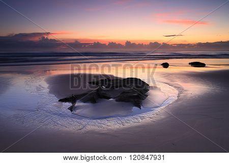 Sunrise Reflections On The Beach