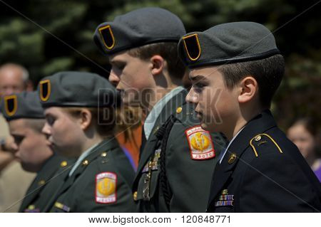 Bangor, Maine/USA-May 26: Sharply dressed youth in uniform from an JRROTC unit march in the Memorial Day Parade on May 26, 2014 in Bangor, Maine.