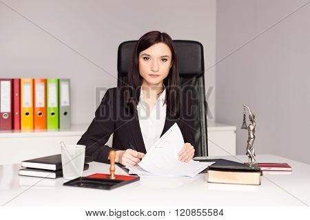 Brunette Woman Notary Public Signing Testament.