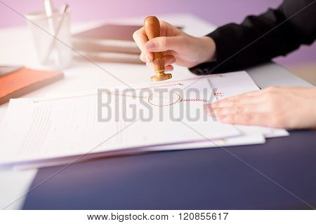 Notary Public Stamping The Document