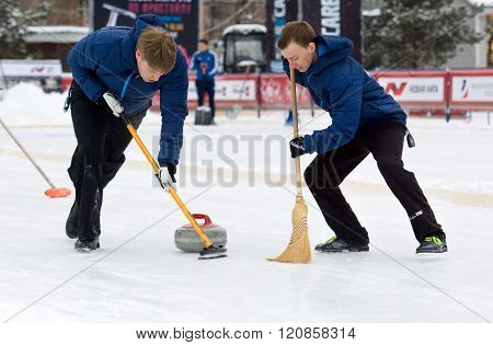 Curling Players D. Abanin (l) And A. Kirikov (r)