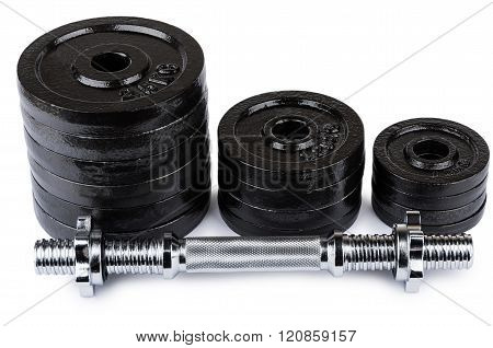 Ajustable Dumbbell  And Stack Of Disks Isolated On White